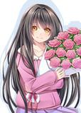 花束をかかえる幼女