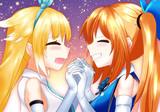 ミライアカリと銀河アリスが幸せそうに両手を繋いで向かい合うシーン
