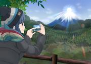 ダイヤモンド富士を写真に収める志摩リン