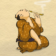 キセルを吸う男