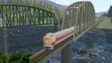 落合川の鉄橋を行く特急しなの
