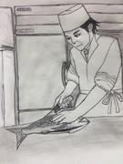 ホモビ撮影を忘れて真剣にイサキを捌く平野料理長