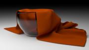 ガラスの器とオレンジ色のナフキン