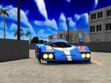 海辺の街、レーシングカーが走る。
