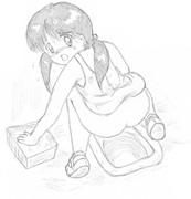 和式トイレにしゃがむ女子小学生