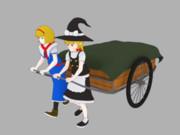 アリスと魔理沙がリアカーを引くところ