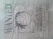 学校の机に手配書を描いてみた