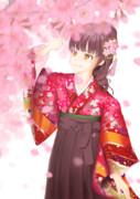 舞う桜を眺める少女