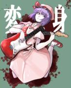 エレキギターを弾くHSK姉貴