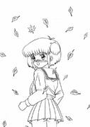 落葉の中の女の子