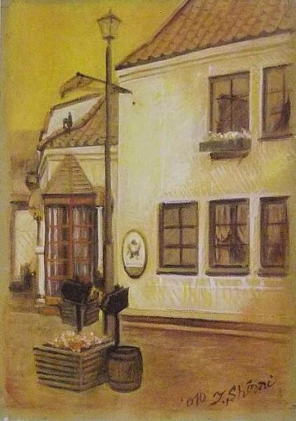 街灯と電話ボックスの在る家の前
