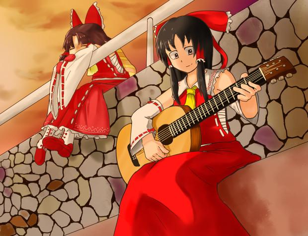 紅に染まる海の前で SNNN姉貴ギターを鳴らす