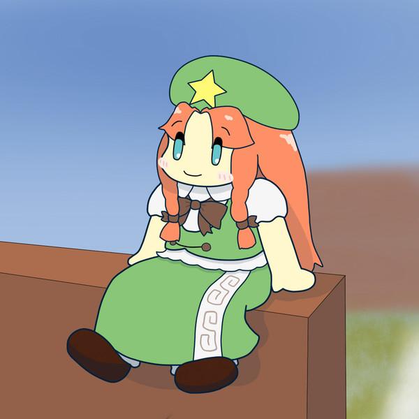 塀の上に座る美鈴